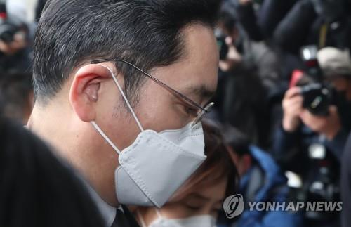 Samsung's Lee sentenced to 30 months in jail over bribery scandal