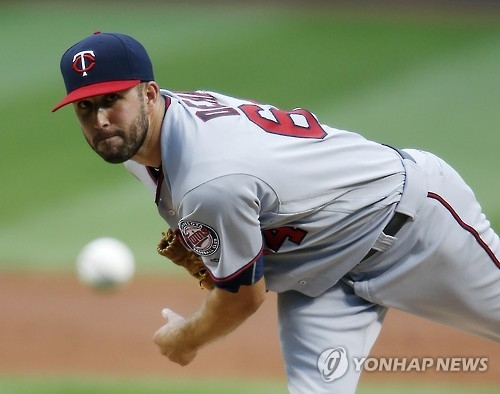 In this Associated Press photo taken on Aug. 31, 2016, Pat Dean, then of the Minnesota Twins, pitches against the Cleveland Indians at Progressive Field in Cleveland. Dean has signed with the Kia Tigers in the Korea Baseball Organization.