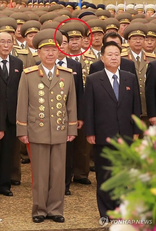 This photo, carried by North Korea's main newspaper Rodong Sinmun on April 16, 2017, shows Ri Pyong-chol, circled in red, a key party official in charge of North Korea's strategic weapons development. He is presumed to have assumed the title of an army general. (For Use Only in the Republic of Korea. No Redistribution) (Yonhap)