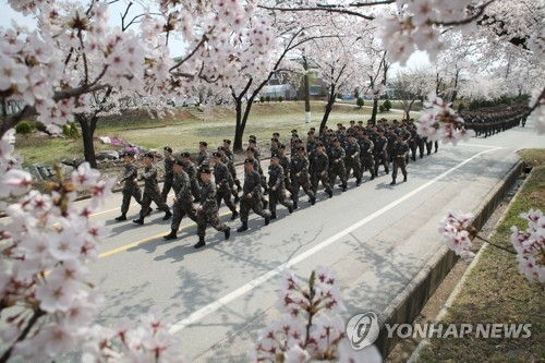 This undated photo shows a unit of South Korean soldiers marching inside their base. (Yonhap)