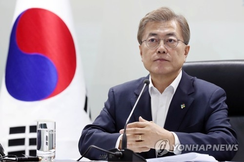 This photo, provided by the presidential office Cheong Wa Dae on June 8, 2017, shows President Moon Jae-in presiding over a National Security Council meeting at the presidential compound's crisis management center in Seoul. (Yonhap)