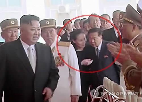 In this file photo captured from the North's Korean Central Television on April 15, 2017, Kim Yo-jong, younger sister of North Korean leader Kim Jong-un (circled, L) and Choe Ryong-hae (circled, R) are seen speaking while accompanying Kim during a military parade marking the 105th birthday of late state founder Kim Il-sung. (For use only in the Republic of Korea. No Redistribution) (Yonhap)