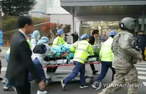 An apparent North Korean soldier, shot by fellow troops while defecting to South Korea, is transported to a local hospital on Nov. 13, 2017 (Yonhap)