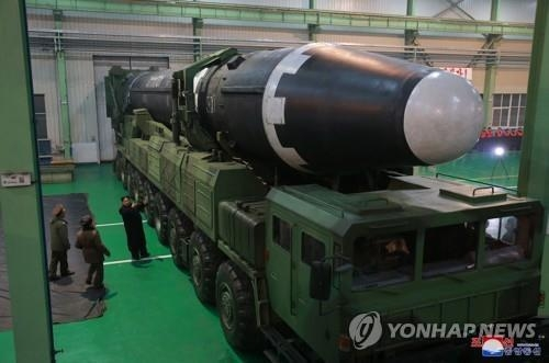 North Korea's new Hwasong-15 ICBM lies mounted on a mobile launcher in this photo released by its state media. (For Use Only in the Republic of Korea. No Redistribution) (Yonhap)