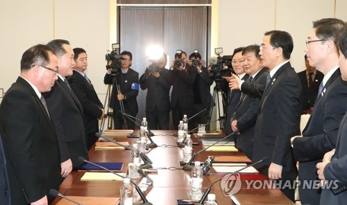 This photo, taken by the Joint Press Corps on Jan. 9, 2018, shows negotiators from South Korea (R) and North Korea after high-level talks at the border truce village of Panmunjom. (Yonhap)