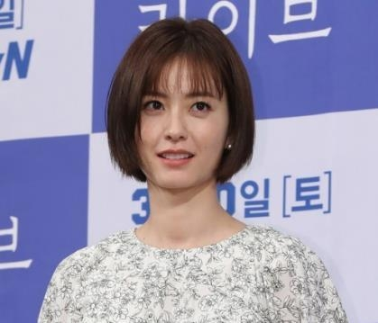 "Actress Jung Yu-mi makes an appearance during a media event in Seoul for tvN's new series ""Live"" on March 6, 2018. (Yonhap)"