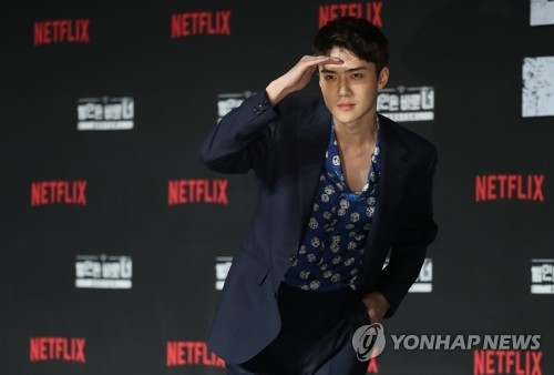 "Sehun of K-pop band EXO poses for photos during a press event for ""Busted! I Know Who You Are"" in Seoul on April 30, 2018. (Yonhap)"