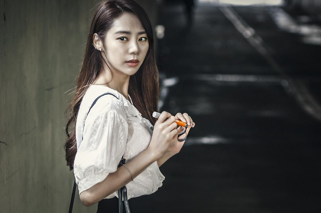 "A model poses with SK Telecom Co.'s self-defense gadget, ""My Hero,"" in this photo released by the company on July 5, 2018. (Yonhap)"