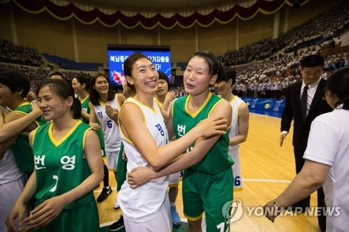 In this pool photo taken on July 5, 2018, South Korea's Lim Yung-hui (L) hugs North Korea's Roh Suk-yong after an inter-Korean friendly basketball event in Pyongyang. (Yonhap)