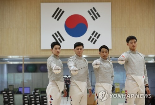 From left: South Korean sabre fencers Kim Jun-ho, Gu Bon-gil, Kim Jung-hwan and Oh Sang-uk pose for photos during the media day event at the Jincheon National Training Center in Jincheon, 90 kilometers south of Seoul, on Aug. 6, 2018. They will compete in the Aug. 18-Sept. 2 Asian Games in Jakarta and Palembang, Indonesia. (Yonhap)