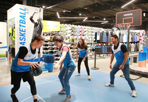 This undated photo, provided by Decathlon Korea, shows its employees playing basketball at its first Korean store in Incheon, west of Seoul. The store will open to the public on Sept. 15, 2018. (Yonhap)