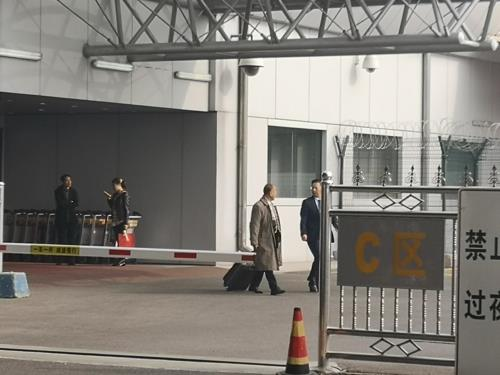 Song Il-hyok (C), deputy director general of North Korea's Institute for Disarmament and Peace, arrives at Beijing's Capital International Airport on Oct. 22, 2018. (Yonhap)