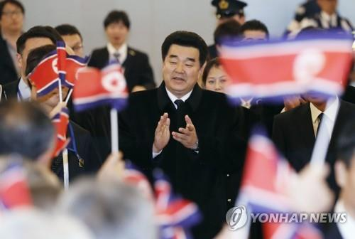 North Korea's sports minister, Kim Il-guk (C), arrives in Tokyo for an Olympics-related session on Nov. 27, 2018. (Yonhap)