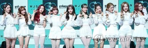 "Cosmic Girls pose for photos during a media event to announce the release of their new album ""WJ Stay?"" on Jan. 8, 2019. (Yonhap)"