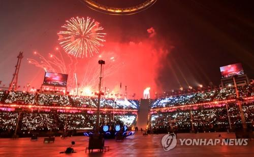 Fireworks light up the sky at the Olympic Stadium in PyeongChang at the opening ceremony of the Winter Olympics on Feb. 9, 2018. (Yonhap)
