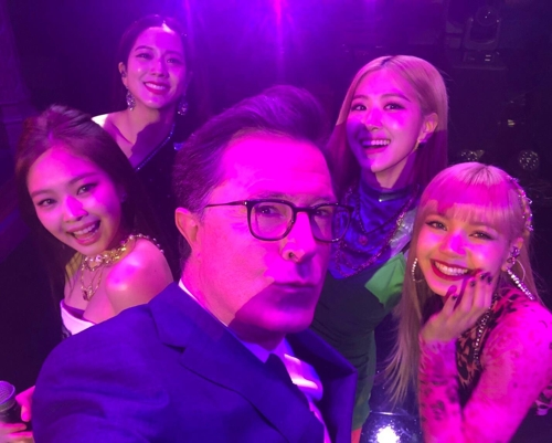"This photo of BLACKPINK and Stephen Colbert, the host of ""The Late Show with Stephen Colbert,"" on Feb. 11, 2019 is provided by the American television network CBS. (Yonhap)"