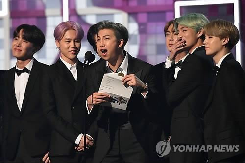 This photo distributed by Reuters shows BTS team leader RM (C) announcing the winner of the Best R&B Album during the 61st Grammy Awards on Feb. 10, 2019, in Los Angeles, the United States. (Yonhap)
