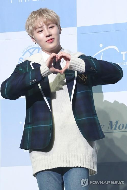 "Ha Sung-woon poses for photos during a media showcase of his first solo album, ""My Moment,"" on Feb. 27, 2019. (Yonhap)"