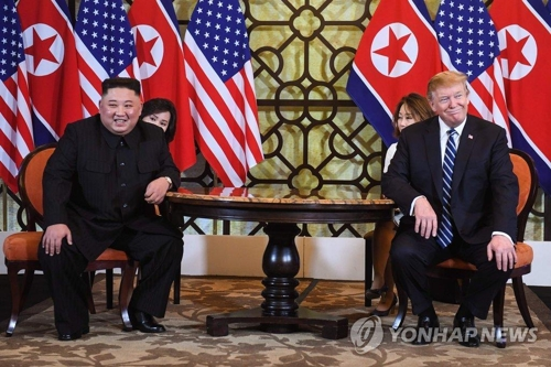 This AFP photo shows North Korean leader Kim Jong-un and U.S. President Donald Trump seated together at the Sofitel Legend Metropole Hanoi hotel on Feb. 28, 2019. (Yonhap)
