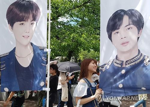 This photo shows Japanese fans ahead of BTS' July 6 concert at the 47,000-seat Yanmar Stadium Nagai in Osaka. (Yonhap)