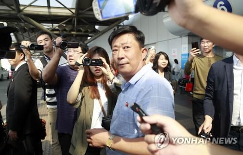 A man, believed to be Jo Chol-su, head of the North Korean foreign ministry's North American affairs department, is seen at Beijing International Capital Airport upon arrival from Pyongyang on Oct. 3, 2019. The North Korean delegation, led by Kim Myong-gil, is expected to leave for Sweden for the envisioned denuclearization talks with the United States. (Yonhap)