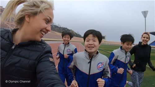In this photo provided by the Olympic Channel on Oct. 4, 2019, Aimee Fuller of Britain (L) and Mirjam Jaeger of Switzerland (R) train with North Korean athletes in preparation for the Mangyongdae Prize International Marathon in Pyongyang on April 7, 2019. (PHOTO NOT FOR SALE) (Yonhap)