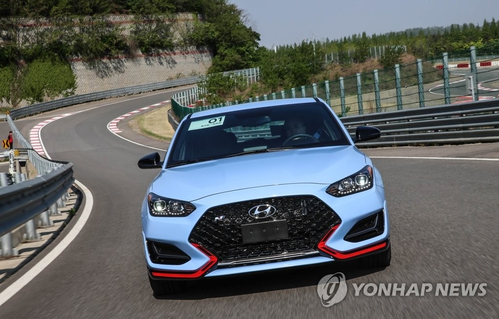 This undated file photo provided by Hyundai Motor shows a Veloster N performance car running on a road. (PHOTO NOT FOR SALE) (Yonhap)