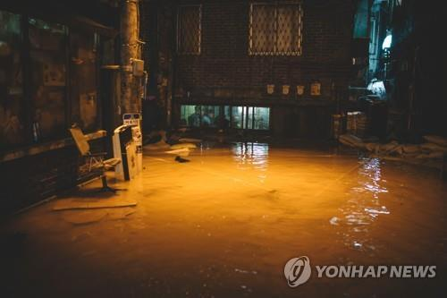 "This photo provided by Goyang City Hall shows a flooding scene from ""Parasite."" (PHOTO NOT FOR SALE) (Yonhap)"
