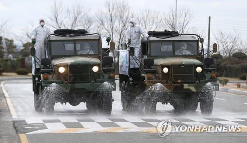 Quarantine vehicles from the Army's 53rd Infantry Division spray disinfectant around Ulsan Airport in Ulsan, 410 kilometers southeast of Seoul, on March 3, 2020, joining the nationwide fight against the novel coronavirus. (Yonhap)