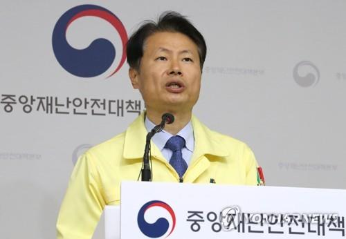 Vice Health Minister Kim Ganglip speaks during a press conference at the government complex in Sejong, central South Korea, on March 9, 2020, about the spread of the new coronavirus that has hit the country.