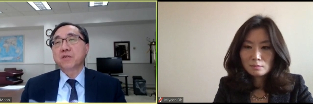 This screenshot shows Moon Seoung-hyun (L), deputy chief of mission for the South Korean Embassy in Washington, speaking during a virtual discussion on South Korea's response to COVID-19, with Oh Miyeon, director and senior fellow for the Asia Security Initiative at the Atlantic Council's Scowcroft Center for Strategy and Security. (Yonhap)