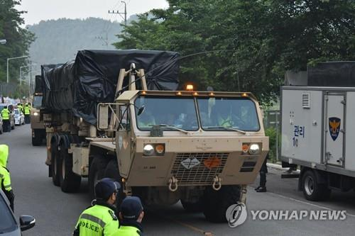 Military vehicles transport equipment to the site of the Terminal High Altitude Area Defense (THAAD) base in the town of Seongju, about 220 km south of Seoul, on May 29, 2020, as part of an upgrade, in this photo released by a group of residents and activists opposing the installation of the missile defense system. U.S. Forces Korea and South Korea's defense ministry, which had only used air transportation to move supplies due to strong opposition by local residents until now, are transporting equipment by ground to and from the system's site. (PHOTO NOT FOR SALE) (Yonhap)