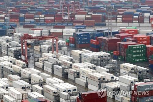 The file photo shows stacks of import-export cargo containers at South Korea's largest seaport in Busan, around 450 kilometers southeast of Seoul. (Yonhap)