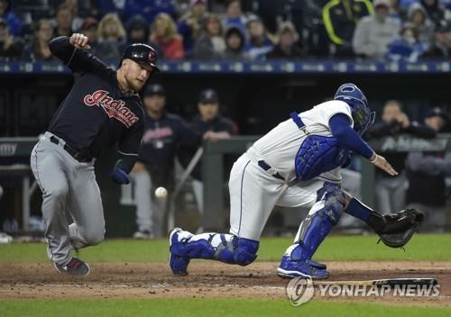 In this Getty Images file photo from Sept. 28, 2018, Brandon Barnes of the Cleveland Indians (L) slides home safely past Kansas City Royals catcher Cam Gallagher during their Major League Baseball regular season game at Kauffman Stadium in Kansas City, Missouri. (Yonhap)