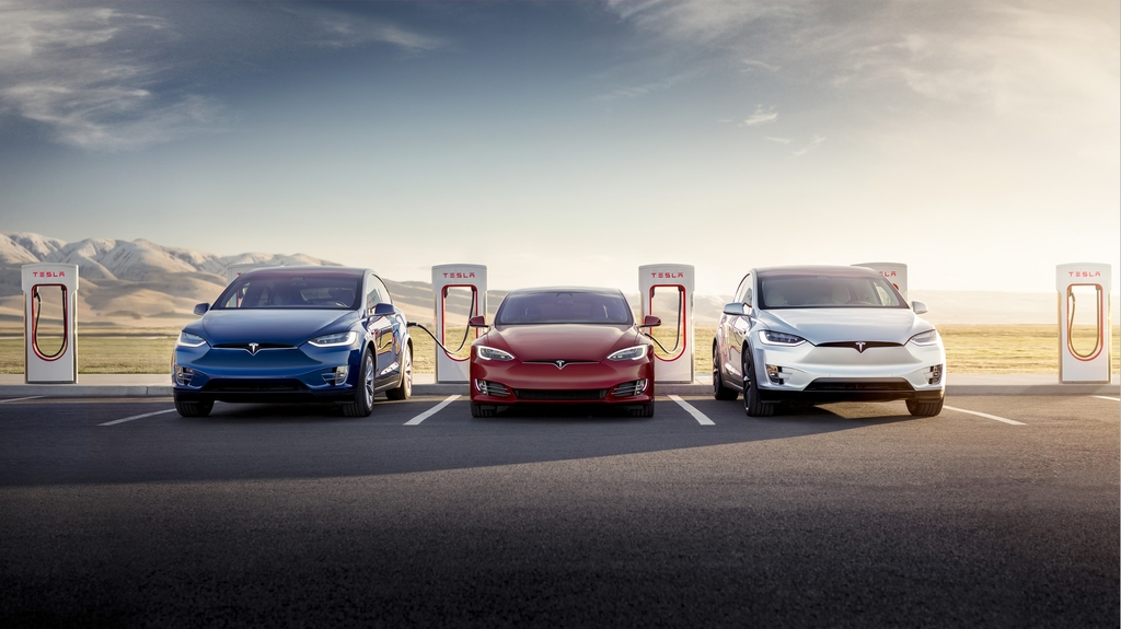 This undated file photo provided by Tesla shows the Model X, Model S and Model X being charged by superchargers. (PHOTO NOT FOR SALE) (Yonhap)