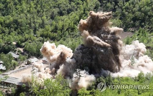 The file photo taken May 24, 2018, shows Tunnel No. 4 at North Korea's only known nuclear test site Punggye-ri being blown up, during the dismantlement of the site. The site was demolished in a series of explosions over several hours on the day, with press members from South Korea, China, Russia, the United States and Britain covering the process carried out in Kilju County of North Hamgyong Province in the country's northeast. (Pool photo) (Yonhap)