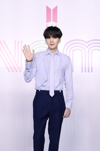 """Suga of K-pop sensation BTS poses for photos during an online press conference for the new single """"Dynamite"""" held in Seoul on Aug. 21, 2020, in this photo provided by Big Hit Entertainment. (PHOTO NOT FOR SALE) (Yonhap)"""
