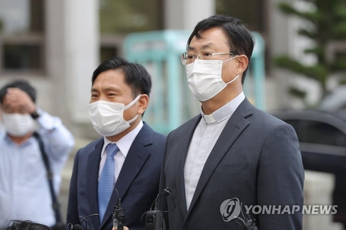 Priest Cho Young-dae, the plaintiff, speaks to the press in front of the Gwangju District Court in the southwestern city of Gwangju on Oct. 5, 2020. (Yonhap)