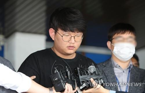 Moon Hyung-wook, a 24-year-old alleged mastermind of a high-profile digital sexual exploitation ring, appears before the press at the Andong Police Station in Andong, 270 kilometers southeast of Seoul, on May 18, 2020. (Yonhap)