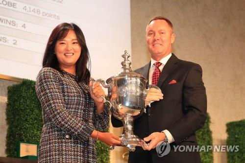 In this Getty Images file photo from Nov. 21, 2019, LPGA Commissioner Mike Whan (R) presents Ko Jin-young of South Korea with the LPGA Player of the Year trophy at the LPGA Rolex Players Awards ceremony at The Ritz-Carlton Golf Resort in Naples, Florida. (Yonhap)
