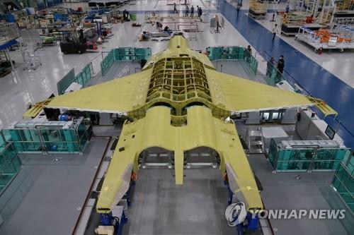 This photo provided by the Defense Acquisition Program Administration on Sept. 3, 2020, shows a prototype of South Korea's envisioned fighter jet being assembled at the Korea Aerospace Industries Co. facility in Sacheon, South Gyeongsang Province, southeastern South Korea. Under the KF-X project worth 8.8 trillion won (US$7.3 billion), South Korea has been working since late 2015 to develop a homegrown cutting-edge fighter aircraft to replace the Air Force's aging fleet of F-4 and F-5 jets. (PHOTO NOT FOR SALE) (Yonhap)