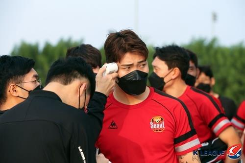 This file photo provided by the Korea Professional Football League shows FC Seoul defender Hwang Hyun-soo undergoing a fever check. (PHOTO NOT FOR SALE) (Yonhap)