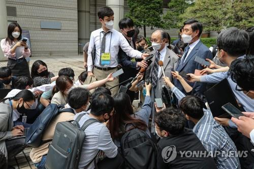Representatives of South Korean wartime forced laborers speak to reporters at the Seoul Central District Court on June 7, 2021, after the court rejected their damages suit against Japanese companies. (Yonhap)