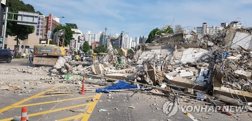 This photo provided by the fire department of Gwangju Metropolitan City shows a building that collapsed during demolition on June 9, 2021. (Yonhap)