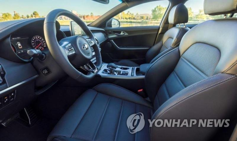 This file photo shows the interior of the Kia Stinger. Alcantara is used in the sports car's dashboard. (Yonhap)