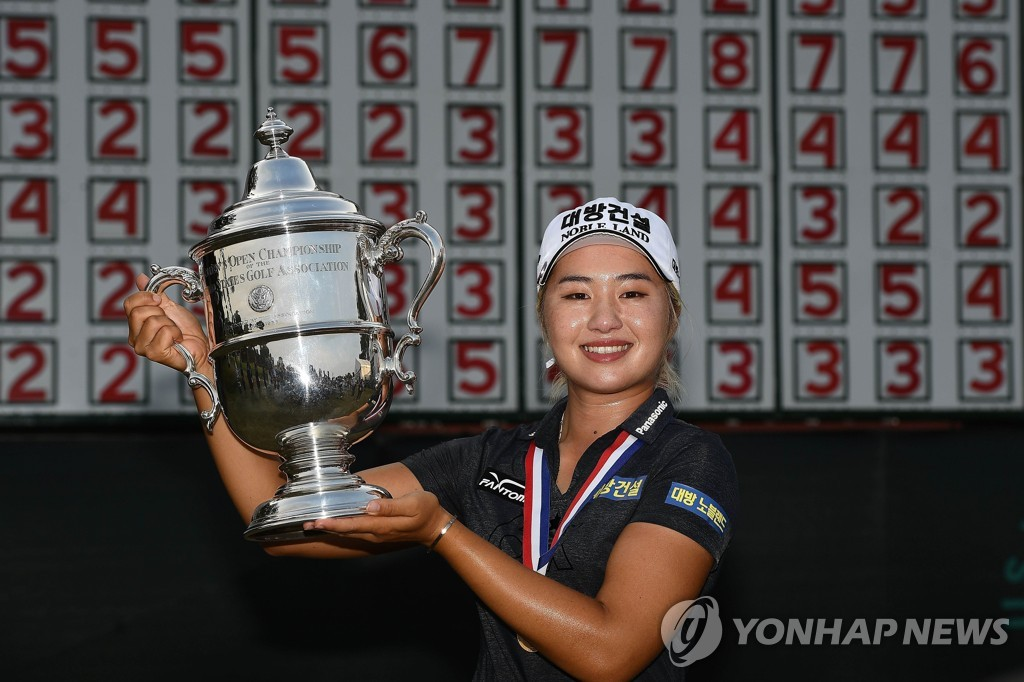 In this Getty Images photo, Lee Jeong-eun of South Korea holds the championship trophy after winning the U.S. Women's Open at the Country Club of Charleston in Charleston, South Carolina, on June 2, 2019. (Yonhap)