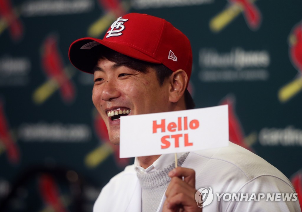 In this UPI file photo from Dec. 17, 2019, South Korean pitcher Kim Kwang-hyun holds up a sign during his introductory press conference with the St. Louis Cardinals at Busch Stadium in St. Louis. (Yonhap)