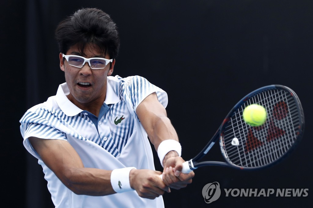In this Reuters photo, Chung Hyeon of South Korea hits a return against Bradley Klahn of the United States during their first round men's singles match at the Australian Open at Melbourne Park in Melbourne on Jan. 15, 2019. (Yonhap)