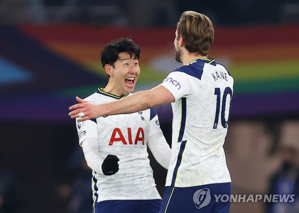 In this Reuters photo, Son Heung-min (L) and Harry Kane of Tottenham Hotspur celebrate Kane's goal during a Premier League match against Crystal Palace at Tottenham Hotspur Stadium in London on March 7, 2021. (Yonhap)