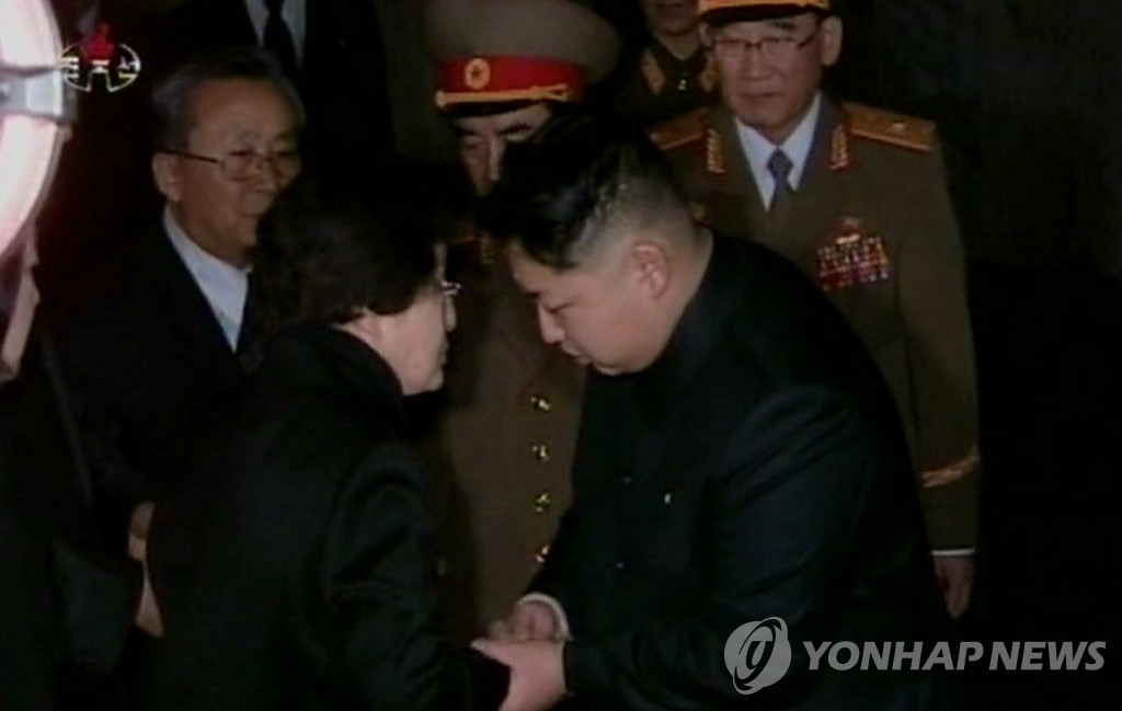 In this file photo, taken on Dec. 26, 2011, North Korean leader Kim Jong-un (R) holds the hands of former first lady Lee Hee-ho, at the Kumsusan Memorial Palace, where the body of Kim Jong-il lies in state, in Pyongyang. This photo is a capture from a Dec. 27 broadcast by the North's Korean Central TV Broadcasting Station. (For Use Only in the Republic of Korea. No Redistribution) (Yonhap)